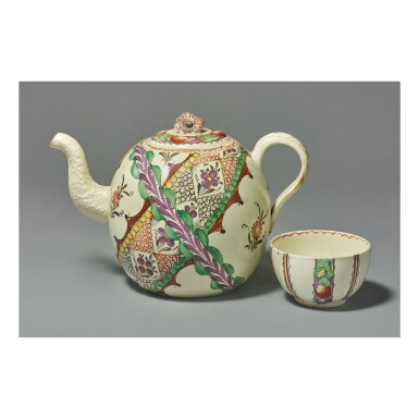 AN ENGLISH CREAMWARE 'CHINTZ' PATTERN TEAPOT AND A COVER AND A TEABOWL, PROBABLY WEDGWOOD CIRCA 1768