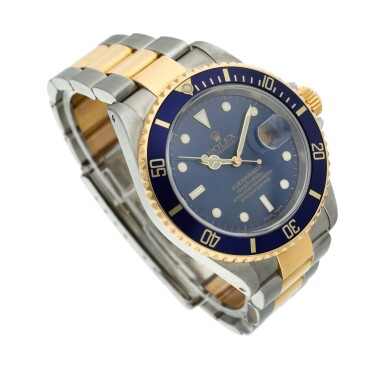 View 3. Thumbnail of Lot 10. Reference 16613 Submariner  A yellow gold and stainless steel wristwatch with date and bracelet, Circa 2002 .