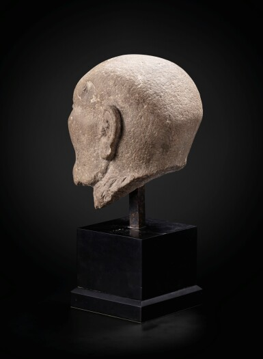 View 4. Thumbnail of Lot 195. A carved limestone head of a fasting Luohan Song dynasty   宋 石灰石雕羅漢首像.