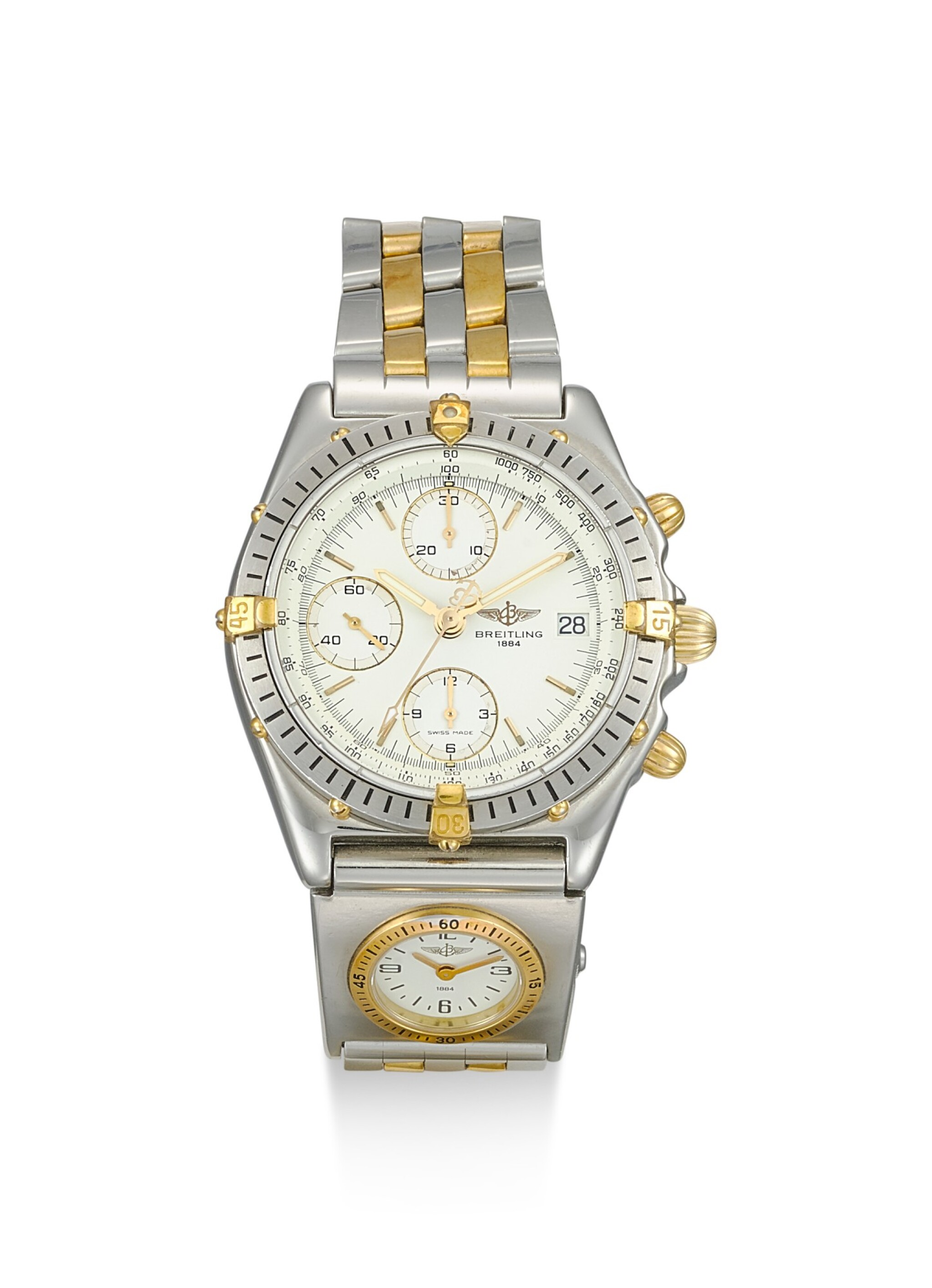 View 1 of Lot 8217. BREITLING | A STAINLESS STEEL AND YELLOW GOLD DUAL TIME ZONE CHRONOGRAPH WRISTWATCH WITH DATE AND BRACELET, CIRCA 2005.
