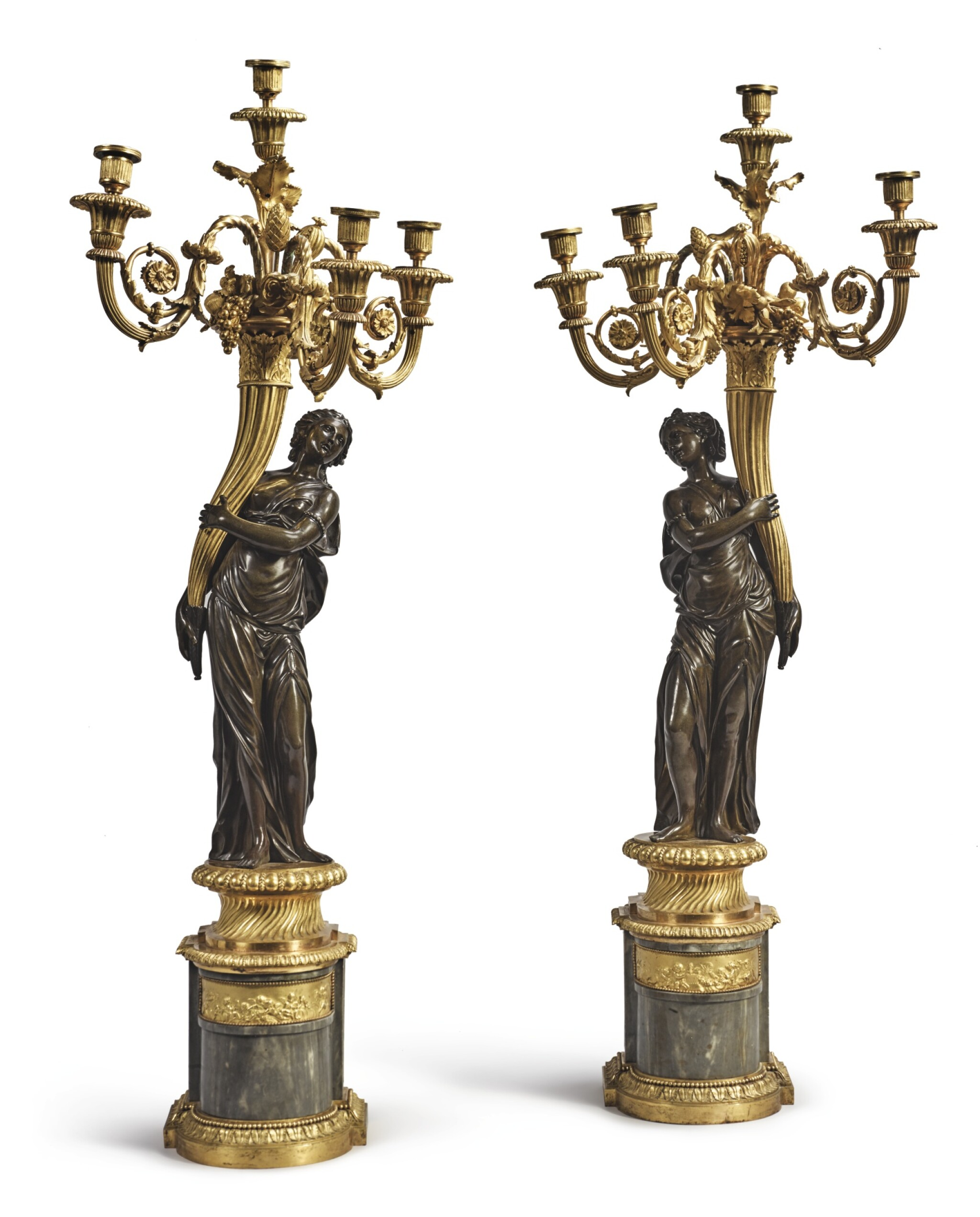View full screen - View 1 of Lot 825. A PAIR OF LOUIS XVI GILT AND PATINATED BRONZE FOUR-LIGHT FIGURAL CANDELABRA ATTRIBUTED TO FRANCOIS REMOND, CIRCA 1785.