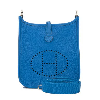 View 1. Thumbnail of Lot 17. Hermès Bleu Zanizbar Evelyne TPM of Clemence Leather with Palladium Hardware.