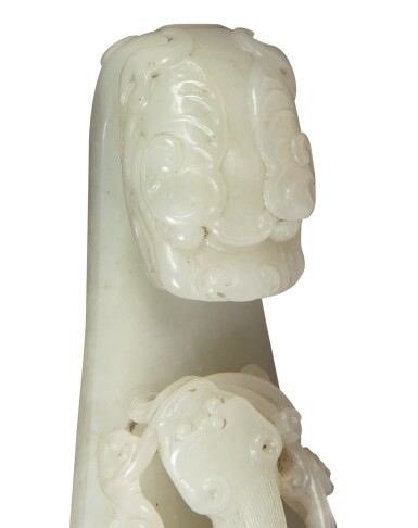 View 8. Thumbnail of Lot 158. A white jade 'chilong' belt hook, Qing dynasty, 18th century.