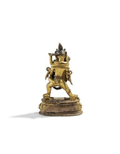 View 2. Thumbnail of Lot 15. STATUETTE DE CHAKRASAMVARA EN ALLIAGE DE CUIVRE DORÉ TIBET, XIVE-XVE SIÈCLE   西藏 十四至十五世紀 鎏金銅合金勝樂金剛立像   A gilt-copper alloy figure of Chakrasamvara, Tibet, 14th/15th century.