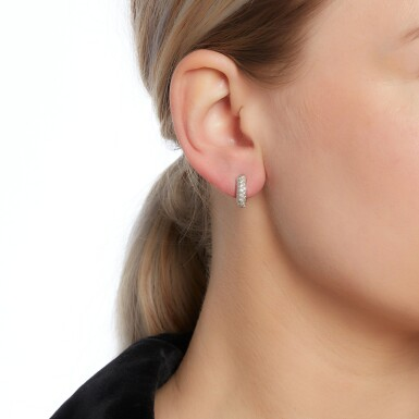 View 4. Thumbnail of Lot 53. Cartier | Pair of diamond earrings.
