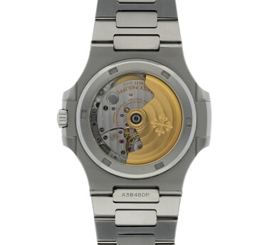 View 4. Thumbnail of Lot 5.  PATEK PHILIPPE   NAUTILUS REF 5711, A STAINLESS STEEL AUTOMATIC WRISTWATCH WITH DATE AND BRACELET CIRCA 2015.