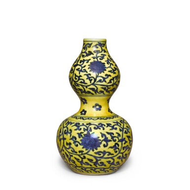 View 1. Thumbnail of Lot 83. A yellow-ground underglaze-blue 'double-gourd' vase, Mark and period of Jiajing | 明嘉靖 黃地青花纏枝蓮紋葫蘆瓶 《大明嘉靖年製》款.