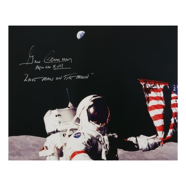 View 1. Thumbnail of Lot 212. [APOLLO 17]. GENE CERNAN SETTING UP THE FINAL LUNAR FLAG. COLOR PHOTOGRAPH, SIGNED AND INSCRIBED BY CERNAN.