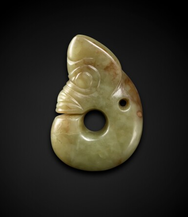 View 2. Thumbnail of Lot 83. An important celadon and russet jade 'pig-dragon', zhulong Neolithic period, Hongshan culture   新石器時代 紅山文化青白玉豬龍.