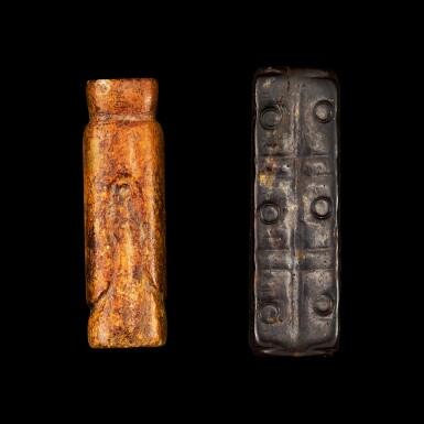 View 2. Thumbnail of Lot 135. A celadon jade 'figure' bead and a black jade cong Qing dynasty   清 墨玉琮式及青玉翁仲形管珠一組兩件.