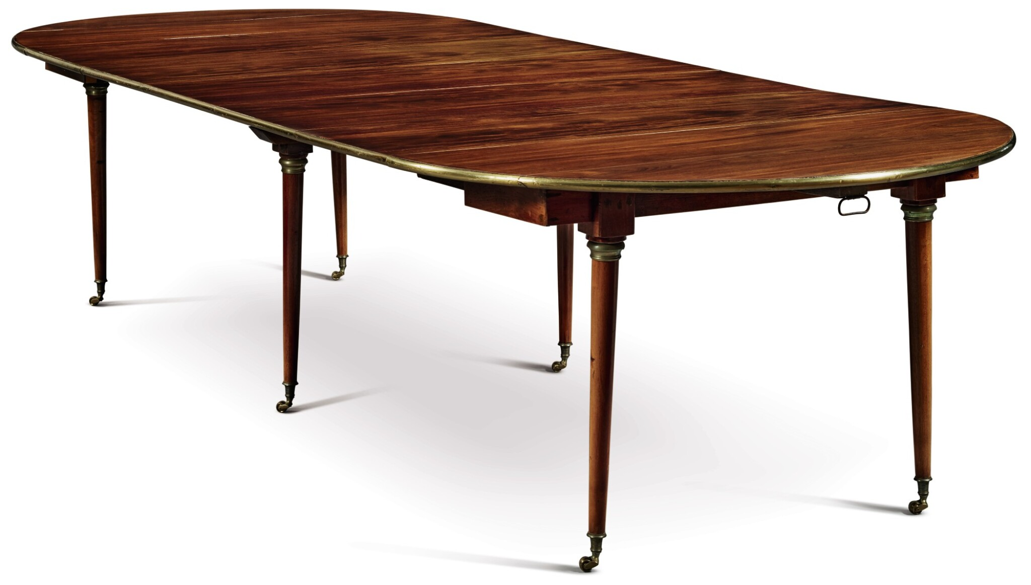 View full screen - View 1 of Lot 1529. DIRECTOIRE BRASS-MOUNTED MAHOGANY OVAL DINING TABLE WITH LATER LEAVES, EARLY 19TH CENTURY.