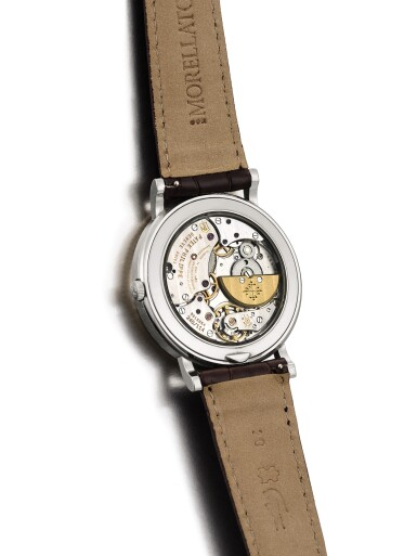 """View 3. Thumbnail of Lot 2043. PATEK PHILIPPE   REFERENCE 5139, A WHITE GOLD PERPETUAL CALENDAR WRISTWATCH WITH MOON PHASES, 24 HOURS AND LEAP YEAR INDICATION, MADE IN 2010   百達翡麗   """"型號5139 白金萬年曆腕錶,備月相、24小時及閏年顯示,機芯編號5513864,錶殼編號4727337,2010年製""""."""