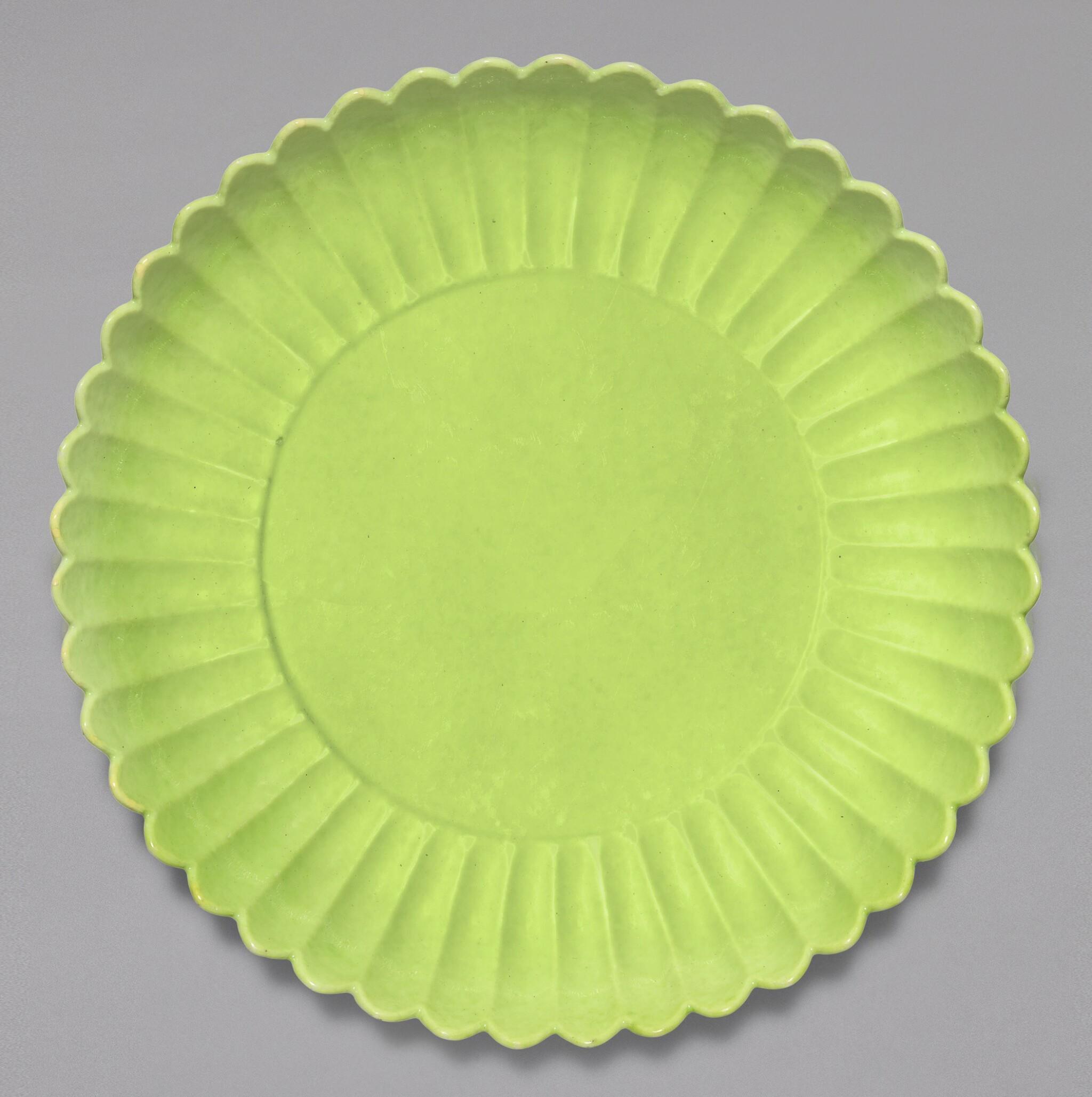 View full screen - View 1 of Lot 6. A RARE LIME GREEN-ENAMELLED 'CHRYSANTHEMUM' DISH, YONGZHENG MARK AND PERIOD | 清雍正 青綠釉菊瓣盤 《大清雍正年製》款.