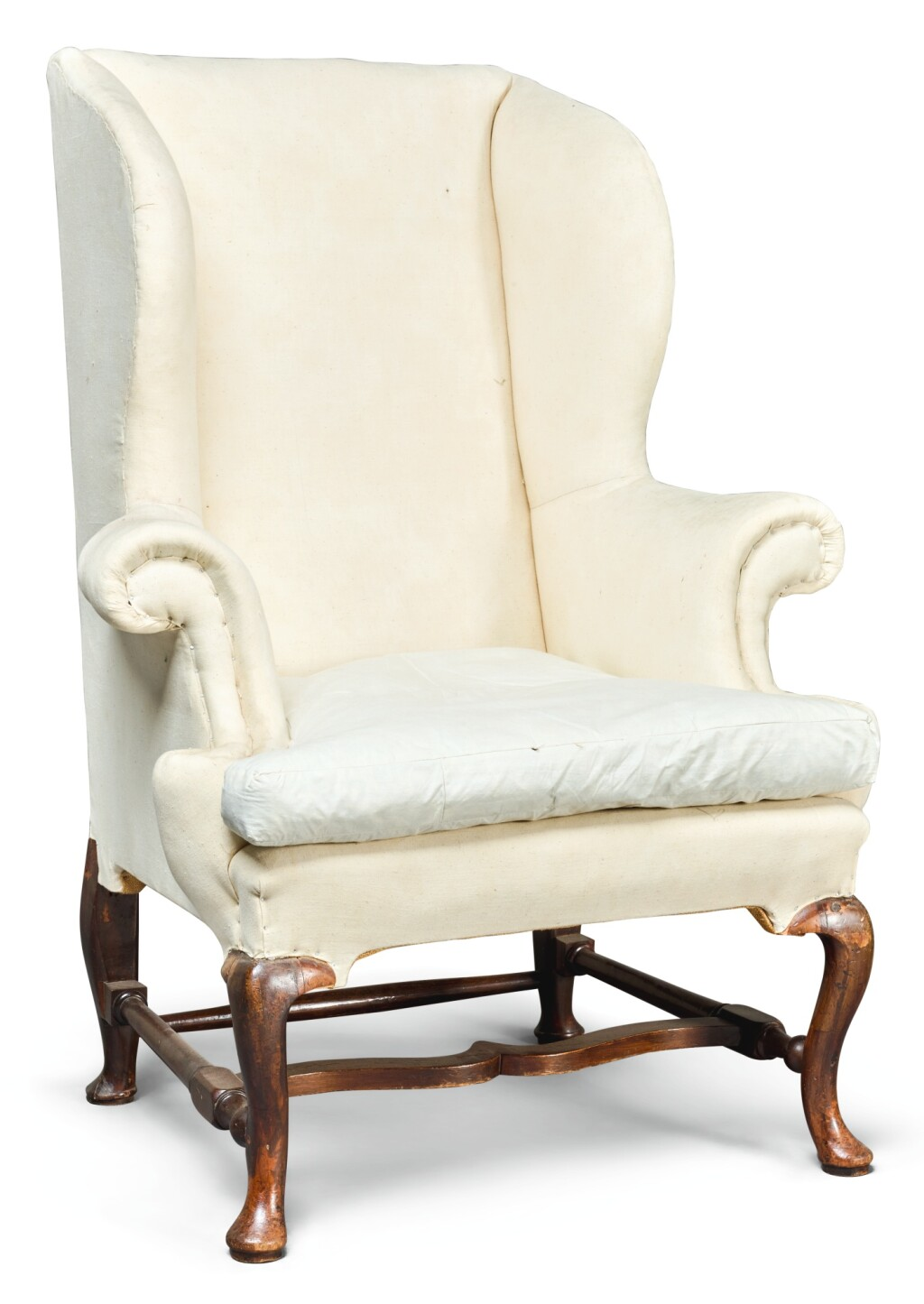 A GEORGE I WALNUT WING-BACK ARMCHAIR