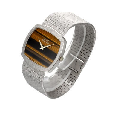 View 2. Thumbnail of Lot 1204. PIAGET | REF 12731 A6, WHITE GOLD BRACELET WATCH WITH TIGER'S EYE DIAL CIRCA 1990.