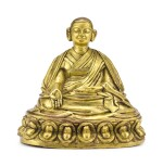 A GILT-BRONZE FIGURE OF A LAMA, TIBET, 18TH CENTURY   十八世紀 藏傳鎏金銅喇嘛坐像
