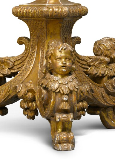 View 6. Thumbnail of Lot 30. A pair of George II carved giltwood torchères, second quarter 18th century, after a design by Alexis Loir.
