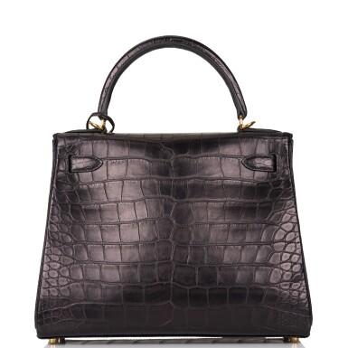 View 4. Thumbnail of Lot 44. Hermès Black Retourne Kelly 28cm of Matte Alligator with Gold Hardware.