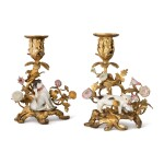 TWO MEISSEN FIGURES OF A PUG AND A CAT MOUNTED ON GILT-BRONZE CANDLESTICKS, THE PORCELAIN AND MOUNTS, MID-18TH CENTURY
