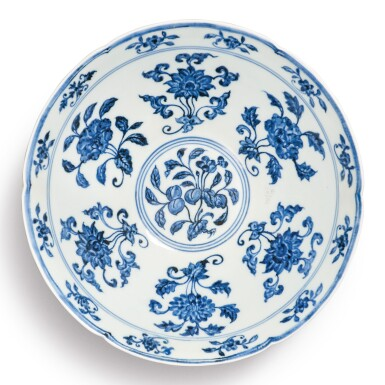 View 1. Thumbnail of Lot 131. A finely painted blue and white lobed 'fruit and flower' bowl, Xuande mark and period | 明宣德 青花折枝花果紋葵口碗  《大明宣德年製》款.