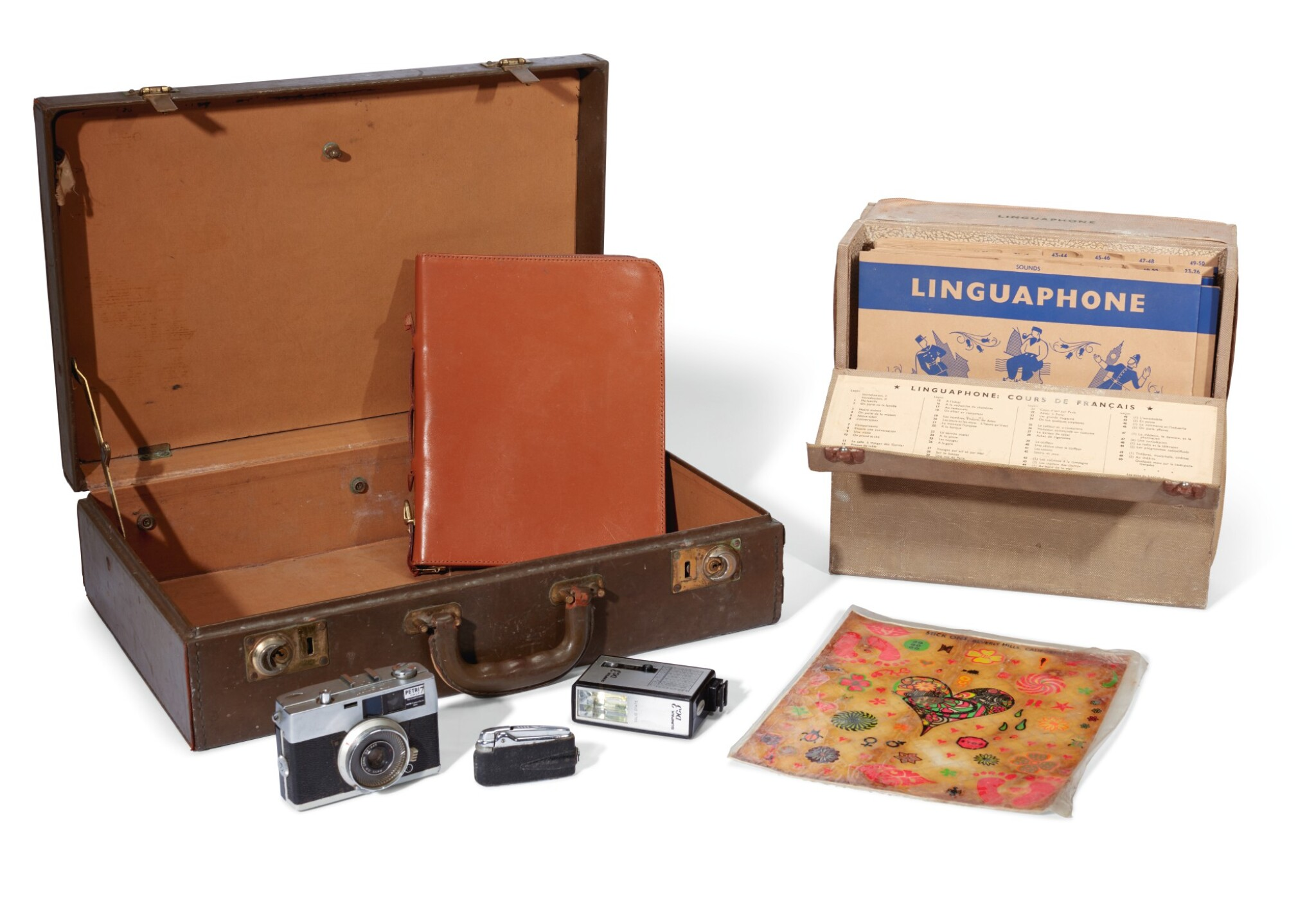 View full screen - View 1 of Lot 13. THE BEATLES   Ronson cigarette lighter; Petri Half 7 Camera & Solid State DC3 Flash; leather writing case & small case.