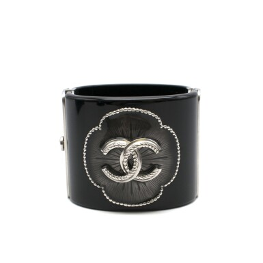 View 1. Thumbnail of Lot 174. CHANEL | BLACK PERSPEX CUFF WITH A RESIN FILLED CAMELIA STUDDED FLORAL OUTLINE AND ANTHRACITE TONE HARDWARE AND CC EMBELLISHMENT, 2015.