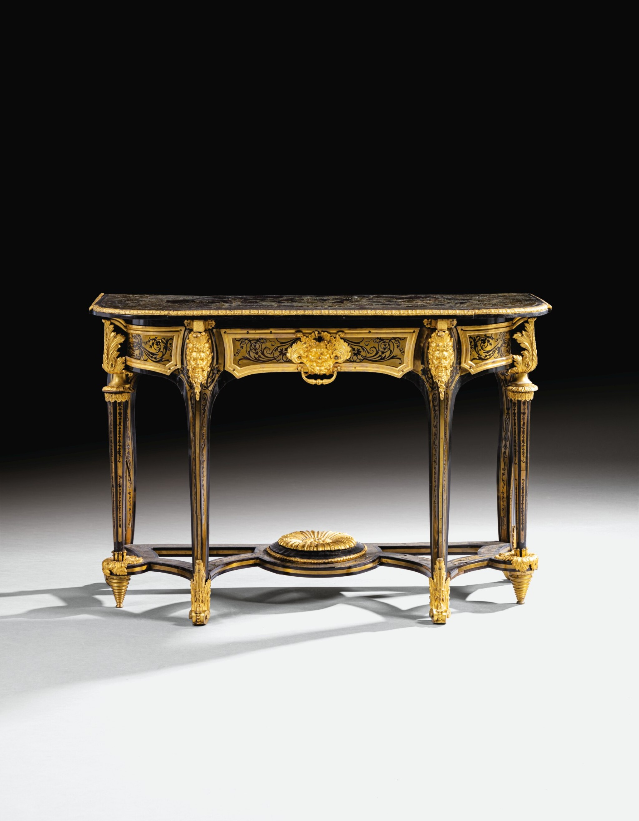 View full screen - View 1 of Lot 7. A GILT-BRONZE MOUNTED, BRASS-INLAID AND BROWN TORTOISESHELL BOULLE MARQUETRY CONSOLE TABLE, LOUIS XIV, ATTRIBUTED TO ANDRÉ-CHARLES BOULLE AND HIS WORKSHOP, CIRCA 1710-1720 | TABLE À SIX PIEDS EN MARQUETERIE D'ÉCAILLE BRUNE, LAITON GRAVÉS, PLACAGE D'ÉBÈNE ET BRONZE DORÉ D'ÉPOQUE LOUIS XIV, VERS 1710-1720, ATTRIBUÉE À ANDRÉ-CHARLES BOULLE ET SON ATELIER.