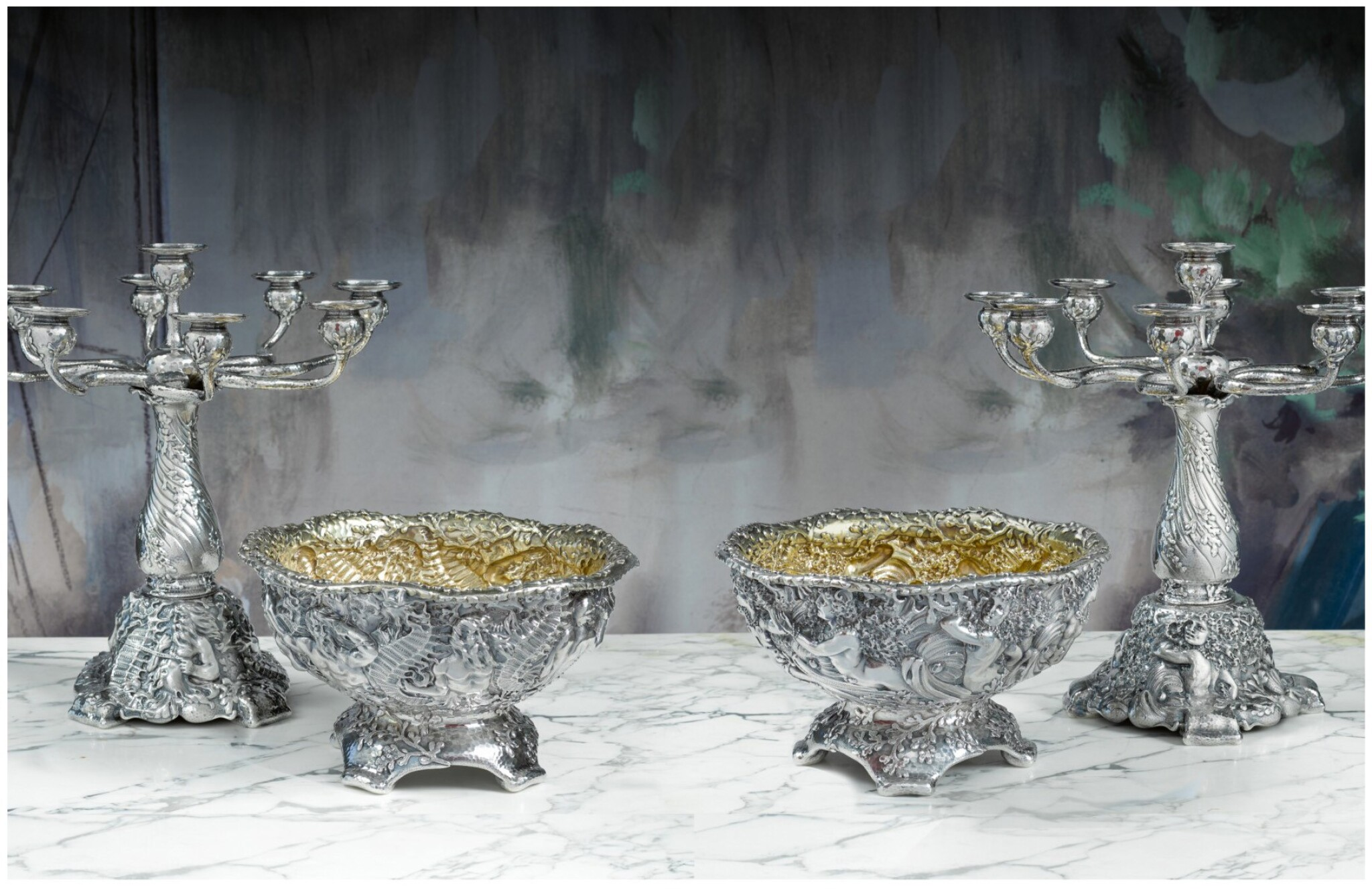 AN AMERICAN SILVER MARINE THEME TABLE GARNITURE: A PAIR OF NINE-LIGHT CANDELABRA AND A PAIR OF CENTERPIECE BOWLS, TIFFANY & CO., NEW YORK, THE DESIGN ATTRIBUTED TO CHARLES OSBORNE, CIRCA 1883