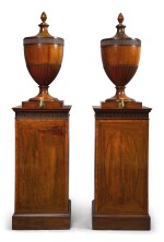 A PAIR OF GEORGE III EBONY AND BOXWOOD INLAID MAHOGANY URNS AND PEDESTALS IN THE MANNER OF GILLOWS, LATE 18TH CENTURY