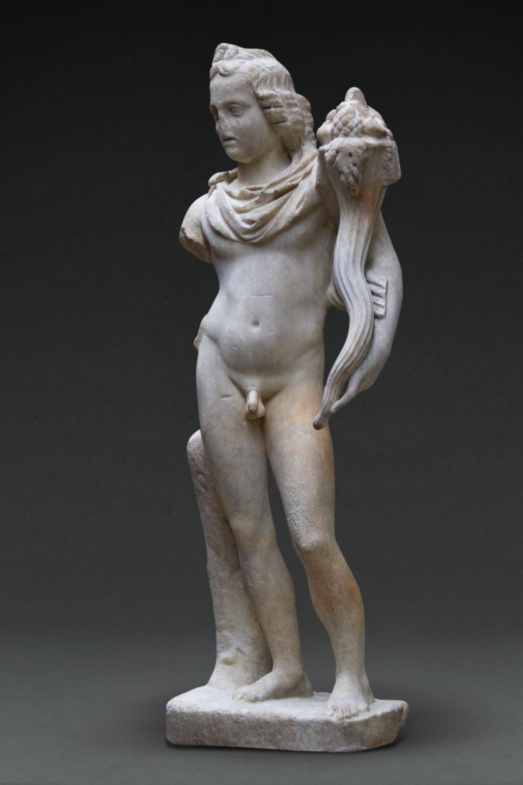 A ROMAN MARBLE FIGURE OF EROS-HARPOCRATES, CIRCA 2ND CENTURY A.D.