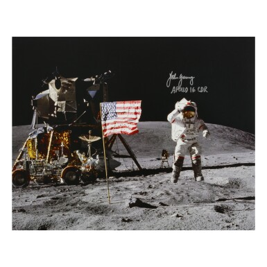 [APOLLO 16]. JOHN YOUNG JUMPING SALUTE. COLOR PHOTOGRAPH, SIGNED AND INSCRIBED BY JOHN YOUNG