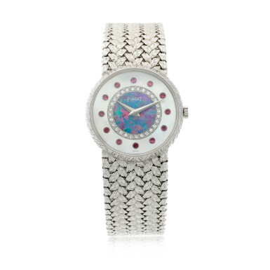 View 2. Thumbnail of Lot 109. Reference 9005 D 2 A white gold, mother-of-pearl, opal, diamond and ruby-set bracelet watch, Circa 1975.