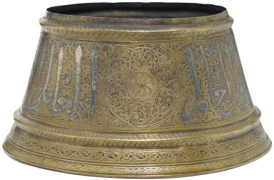 A MAMLUK SILVER-INLAID BRASS CANDLESTICK BASE, EGYPT OR SYRIA, 14TH CENTURY