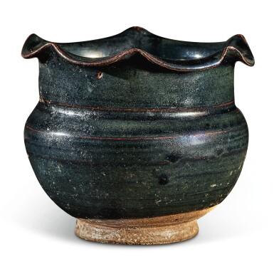 View 1. Thumbnail of Lot 104. A rare black-glazed foliate-rimmed jar, Northern Song / Jin dynasty   北宋 / 金 黑釉花口罐.