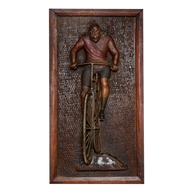 CARVED AND POLYCHROME PAINT-DECORATED WALNUT 'BICYCLIST' WALL PLAQUE, CIRCA 1900