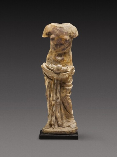 View 1. Thumbnail of Lot 83. A Roman Marble Figure of a Nymph holding a Shell , circa 2nd Century A.D..