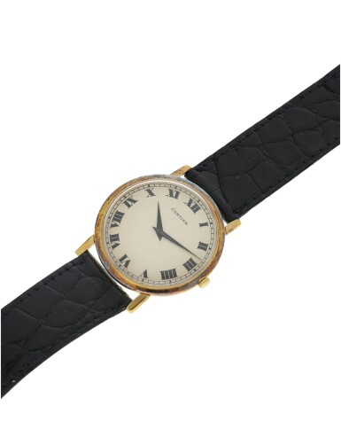 View 6. Thumbnail of Lot 71. RETAILED BY CARTIER: A YELLOW GOLD WRISTWATCH, CIRCA 1970.