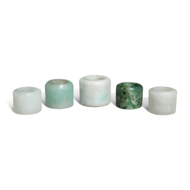 View 4. Thumbnail of Lot 163. Five jade and jadeite archer's rings, 19th / 20th century.