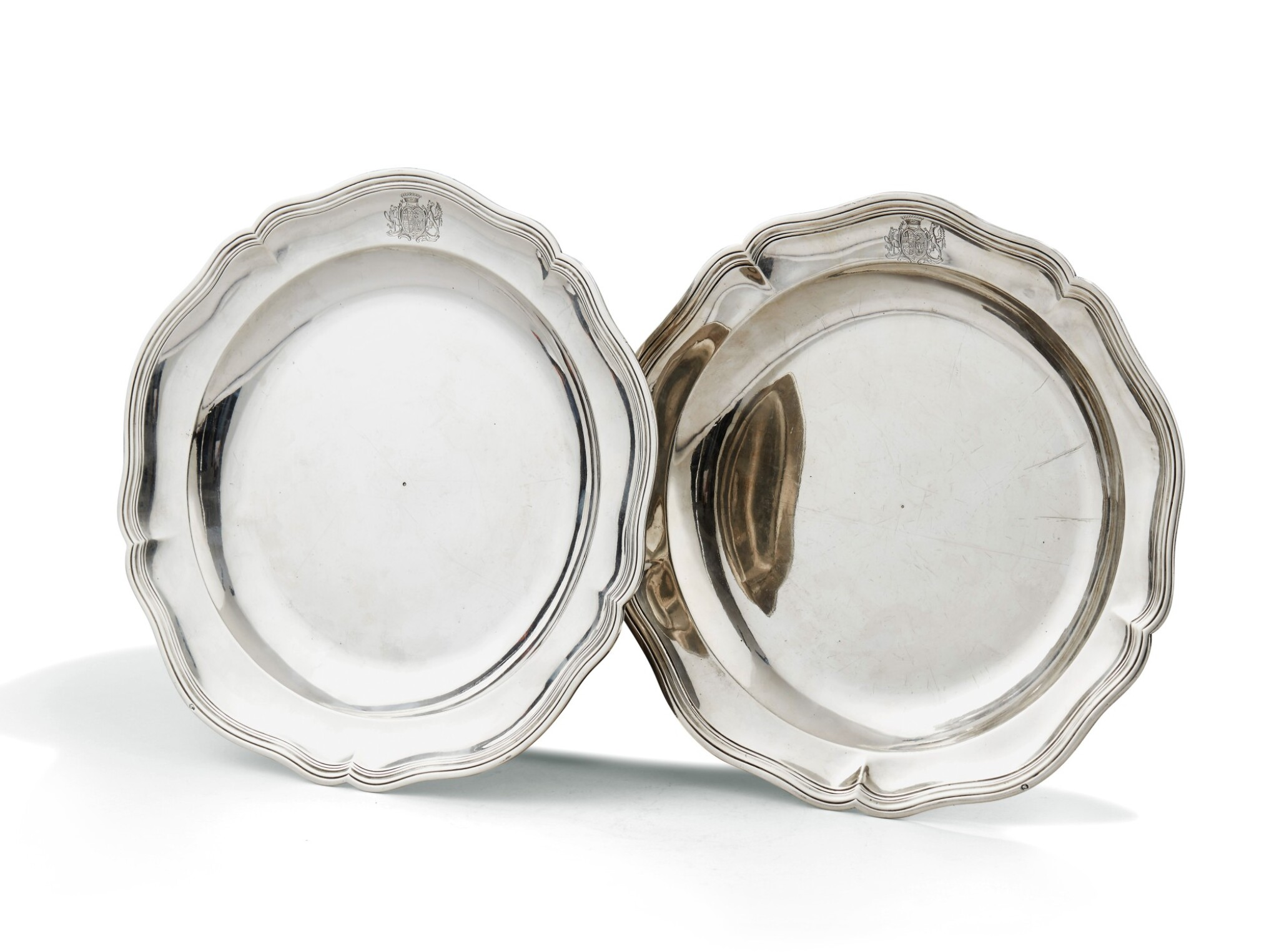 View full screen - View 1 of Lot 173. TWO SILVER CIRCULAR DISHES, PARIS, ONE GUILLAUME PIGERON, 1766-1767, THE OTHER EDME-PIERRE BALZAC, 1750-1751 |  DEUX PLATS RONDS EN ARGENT, PARIS, L'UN PAR GUILLAUME PIGERON, 1766-1767, L'AUTRE PAR EDME-PIERRE BALZAC, 1750-1751.