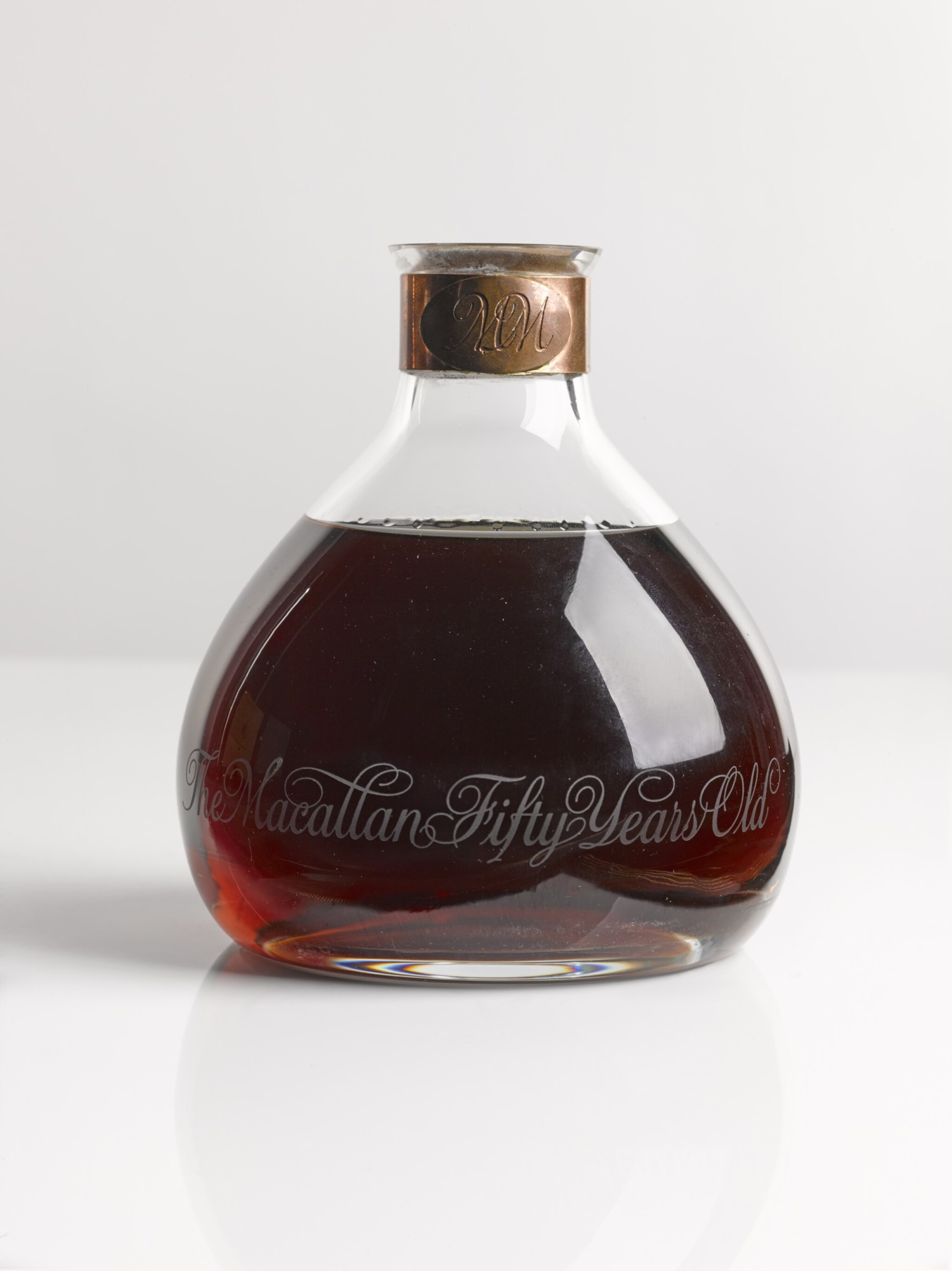 View full screen - View 1 of Lot 6. THE MACALLAN MILLENNIUM DECANTER 50 YEAR OLD.