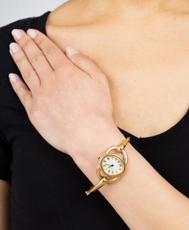 View 4. Thumbnail of Lot 143. Montre bracelet de dame or | Lady's gold bracelet watch.