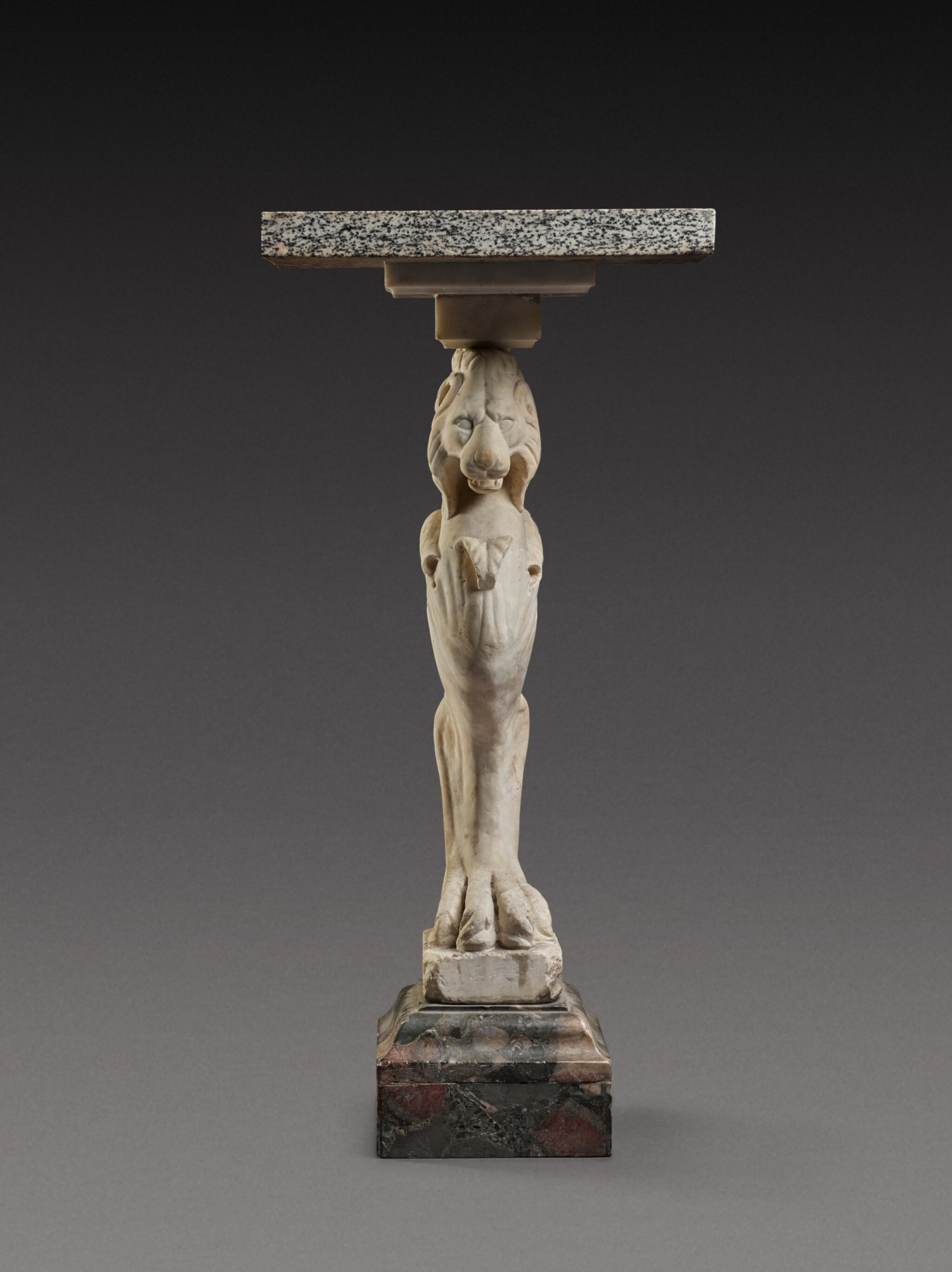 View 1 of Lot 112. A Marble Trapezophoros, probably after the antique.