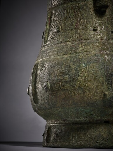 View 6. Thumbnail of Lot 8. A magnificent and rare archaic bronze ritual wine vessel (Hu), Late Shang dynasty   商末 青銅饕餮紋壺.