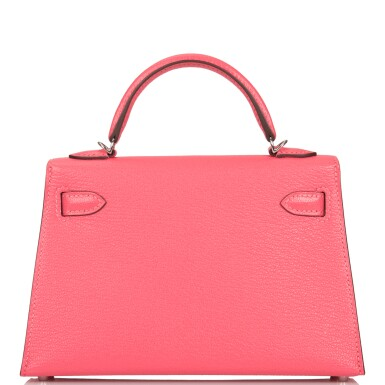 View 5. Thumbnail of Lot 29. HERMÈS   ROSE LIPSTICK SELLIER KELLY 20CM OF CHEVRE LEATHER WITH PALLADIUM HARDWARE.