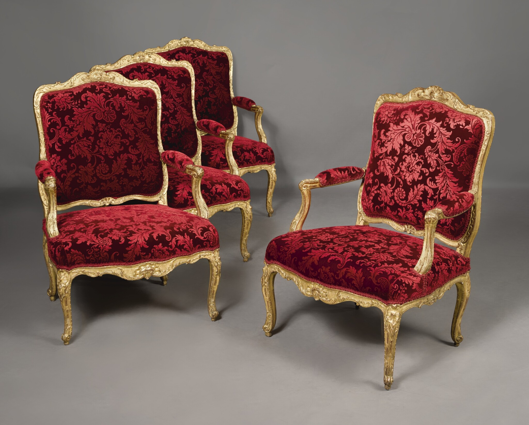 View full screen - View 1 of Lot 785. A SET OF FOUR LOUIS XV CARVED GILTWOOD FAUTEUILS A LA REINE BY BOUCAULT, CIRCA  1735.