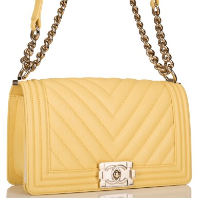 View 2. Thumbnail of Lot 98. CHANEL |  YELLOW CHEVRON OLD MEDIUM BOY BAG OF CAVIAR LEATHER WITH LIGHT GOLD TONE HARDWARE.