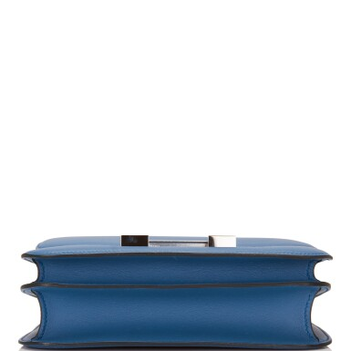 View 5. Thumbnail of Lot 18.  Hermès Bleu Agate Constance 24cm of Swift Leather with Palladium Hardware.