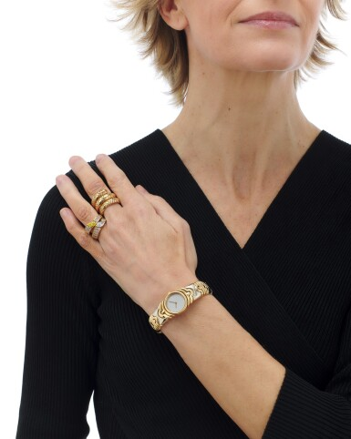 View 4. Thumbnail of Lot 107. 'Parentesi' bracelet-watch and 'Spiga' ring, Bulgari, and two diamond rings (Orologio da polso 'Parentesi' e anello 'Spiga', Bulgari, e due anelli in diamanti).