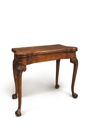A GEORGE II WALNUT GAMES TABLE, CIRCA 1735
