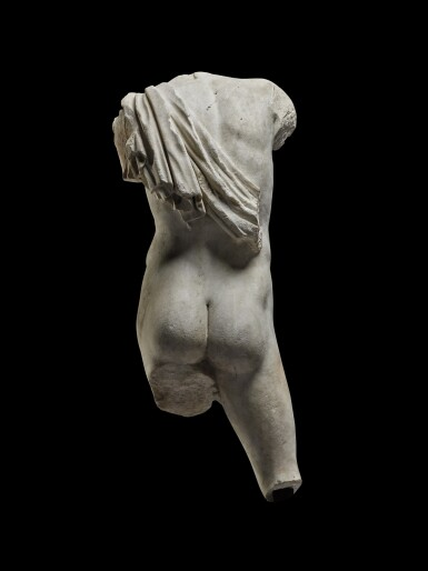 View 2. Thumbnail of Lot 69. A Roman Marble Torso of a Youth, circa 1st Century A.D..